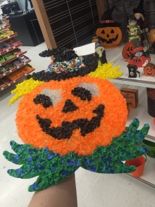 vintage plastic pumpkin hanging from thrift store