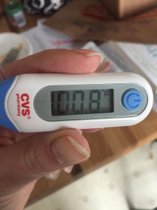 Thermometer showing my temperature of 100.8